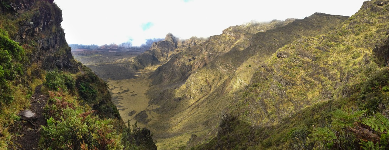 This is how I imagine the Inca trail in Peru - tight singletrack hugging a steep cliff.  See the trail running along the cliff face at the left side of the image.